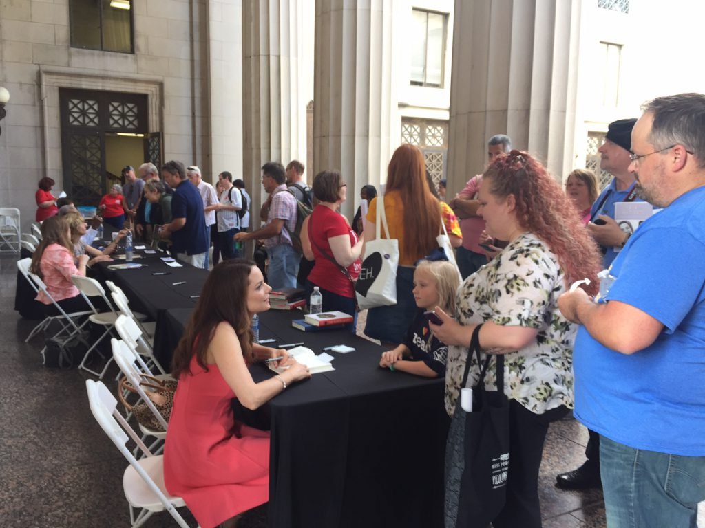 Kimberly signing books after her reading