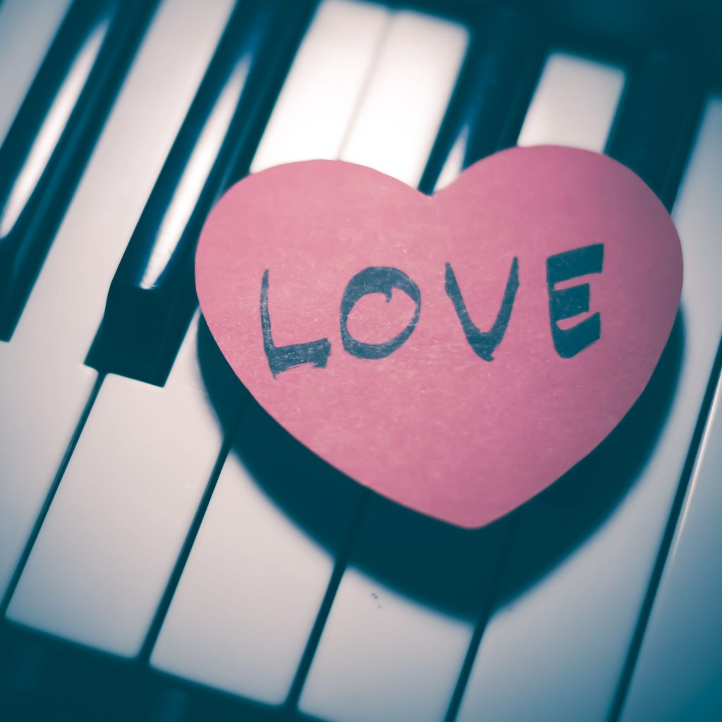 42225320 - heart on key piano say love music vintage style